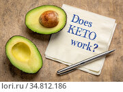 Does KETO work? Handwriting on a napkin with a cut avocado - ketogenic... Стоковое фото, фотограф Zoonar.com/Marek Uliasz / easy Fotostock / Фотобанк Лори