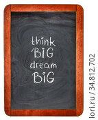 Think big, dream big motivational slogan handwritten with white chalk... Стоковое фото, фотограф Zoonar.com/Marek Uliasz / easy Fotostock / Фотобанк Лори