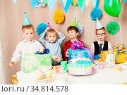 Boys only, happy birthday party with raibow cake. Стоковое фото, фотограф Zoonar.com/Oksana Shufrych / easy Fotostock / Фотобанк Лори