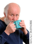 Elderly grey haired man drikns tea or coffee from blue cup isolated... Стоковое фото, фотограф Zoonar.com/Serghei Starus / easy Fotostock / Фотобанк Лори