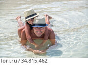 Portrait of a man with her daughter embracing in the water and relaxing... Стоковое фото, фотограф Giovanni Gagliardi / easy Fotostock / Фотобанк Лори