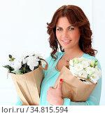 Gorgeous girl with flowers. Стоковое фото, фотограф Zoonar.com/Yeko Photo Studio / easy Fotostock / Фотобанк Лори