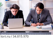 The two young employees working in the office. Стоковое фото, фотограф Zoonar.com/Elnur Amikishiyev / easy Fotostock / Фотобанк Лори