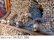 Human skulls and bones Kostnice Sedlec Ossuary, small Roman Catholic... Стоковое фото, фотограф Zoonar.com/Artush Foto / easy Fotostock / Фотобанк Лори