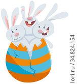 Cartoon Illustration of Funny Three Easter Bunnies Hatching from Large... Стоковое фото, фотограф Zoonar.com/Igor Zakowski / easy Fotostock / Фотобанк Лори