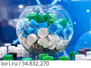 Plastic multi-colored threaded bottle caps. Стоковое фото, фотограф Андрей Радченко / Фотобанк Лори