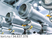 Industrial stainless steel piping connected by special nuts. Стоковое фото, фотограф Андрей Радченко / Фотобанк Лори