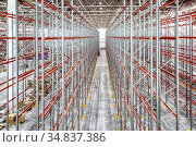 Large warehouse. Tall and long metal shelving. Стоковое фото, фотограф Андрей Радченко / Фотобанк Лори