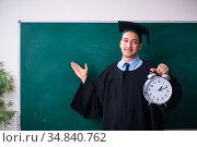 Young male graduate in front of board. Стоковое фото, фотограф Elnur / Фотобанк Лори