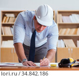 Engineer supervisor working on drawings in the office. Стоковое фото, фотограф Elnur / Фотобанк Лори