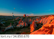 Sunrise panoramic view to Goreme city and flying balloons over pigeon... Стоковое фото, фотограф Zoonar.com/Sergey Mayorov / easy Fotostock / Фотобанк Лори