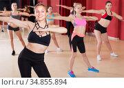 Happy women are practising rouch movement in jazz dance. Стоковое фото, фотограф Яков Филимонов / Фотобанк Лори