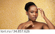 portrait of african woman touching her face. Стоковое фото, фотограф Syda Productions / Фотобанк Лори