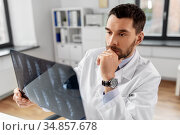 male doctor with x-ray of spine at hospital. Стоковое фото, фотограф Syda Productions / Фотобанк Лори
