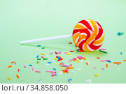 Colorful lollipop and confetti on green. Sweets for party. Стоковое фото, фотограф Papoyan Irina / Фотобанк Лори