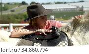 Girl petting a horse in the ranch 4k. Стоковое видео, агентство Wavebreak Media / Фотобанк Лори