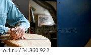 Man making surfboard 4k. Стоковое видео, агентство Wavebreak Media / Фотобанк Лори
