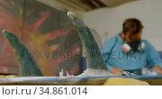 Man grinding surfboard 4k. Стоковое видео, агентство Wavebreak Media / Фотобанк Лори