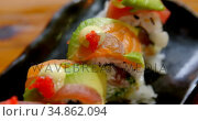 Sushi with rice roll served in a tray 4k. Стоковое видео, агентство Wavebreak Media / Фотобанк Лори