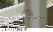 Businesswoman using mobile phone while moving upstairs 4k. Стоковое видео, агентство Wavebreak Media / Фотобанк Лори