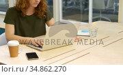 Businesswoman using laptop while having coffee 4k. Стоковое видео, агентство Wavebreak Media / Фотобанк Лори