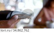 Teenage girl making payment through smartwatch 4k. Стоковое видео, агентство Wavebreak Media / Фотобанк Лори