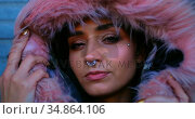 Woman with nose ring and fur jacket standing outside the shop 4k. Стоковое видео, агентство Wavebreak Media / Фотобанк Лори