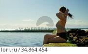 Woman relaxing in the pool at beach 4k. Стоковое видео, агентство Wavebreak Media / Фотобанк Лори