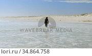 Woman running towards surfboard on the sea 4k. Стоковое видео, агентство Wavebreak Media / Фотобанк Лори
