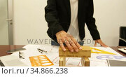 Businesswoman working on blueprint at desk 4k. Стоковое видео, агентство Wavebreak Media / Фотобанк Лори