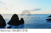 Rock formation in sea at dusk 4k. Стоковое видео, агентство Wavebreak Media / Фотобанк Лори