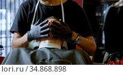 Barber smearing client skin before shaving 4k. Стоковое видео, агентство Wavebreak Media / Фотобанк Лори