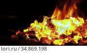 Blacksmith heating metal rod in fire 4k. Стоковое видео, агентство Wavebreak Media / Фотобанк Лори
