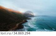 Mountain ranges along the beautiful sea coast 4k. Стоковое видео, агентство Wavebreak Media / Фотобанк Лори