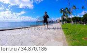 Man running on the promenade at the seaside 4k. Стоковое видео, агентство Wavebreak Media / Фотобанк Лори