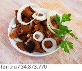 Chopped pickled mushrooms on board. Стоковое фото, фотограф Яков Филимонов / Фотобанк Лори