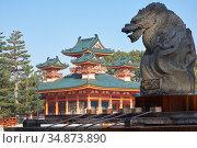 Dragon statue over water ablution basin with Byakko-ro Tower of Heian-jingu Shrine. Kyoto. Japan (2007 год). Стоковое фото, фотограф Serg Zastavkin / Фотобанк Лори