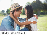Hip young couple embracing each other in the park. Стоковое фото, агентство Wavebreak Media / Фотобанк Лори