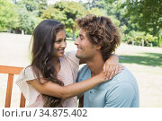 Cute young couple relaxing on park bench together. Стоковое фото, агентство Wavebreak Media / Фотобанк Лори