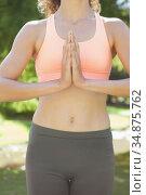 Peaceful woman doing yoga in the park. Стоковое фото, агентство Wavebreak Media / Фотобанк Лори