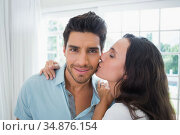 Beautiful girlfriend kissing her boyfriend on the cheek. Стоковое фото, агентство Wavebreak Media / Фотобанк Лори