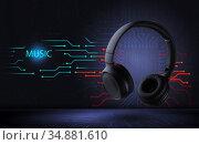 Electronic music. Wireless black headphones on a futuristic background. ... High quality sound. Стоковое фото, фотограф Александр Якимов / Фотобанк Лори