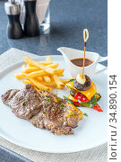 Grilled beef steak with french fried and baked vegetable. Стоковое фото, фотограф Vichaya Kiatying-Angsulee / easy Fotostock / Фотобанк Лори
