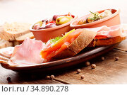Tapas of salmon, mussels, jamon and olives on ceramic plate. Стоковое фото, фотограф Olena Mykhaylova / easy Fotostock / Фотобанк Лори