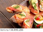 Open sandwiches with salmon on ceramic plate. Стоковое фото, фотограф Olena Mykhaylova / easy Fotostock / Фотобанк Лори