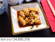 Squid in spicy sauce served on a white plate with onions. Стоковое фото, фотограф Яков Филимонов / Фотобанк Лори
