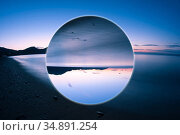 Aesthetic art collage with sunset sea and mountain in surrealism style. Neon light circle frame. Awesome view in ocean and mountain landscape. Contemporary surreal art poster. Zine culture. Стоковое фото, фотограф bashta / Фотобанк Лори