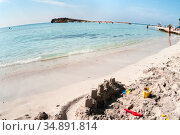 White sand and turquoise sea water are on the Nissi beach. It is a popular beach in the resort of Ayia Napa, Cyprus, Europe. The beach have small islet of Nissi. Wide angle view (2010 год). Стоковое фото, фотограф Кекяляйнен Андрей / Фотобанк Лори