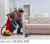 Super hero cleaner working at home. Стоковое фото, фотограф Elnur / Фотобанк Лори
