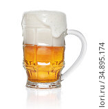 mug of amber beer with foam isolated on white background. Стоковое фото, фотограф Александр Лычагин / Фотобанк Лори